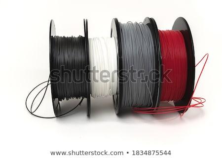 Red thread on black plastic spool Stock photo © snyfer