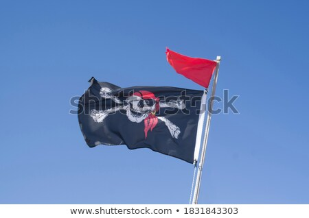 Foto stock: Pirates Flag In Black And Red Outdoor