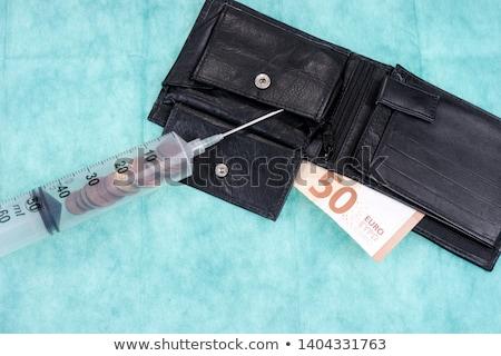 euro currency syringe injection financial metaphor stock photo © lunamarina
