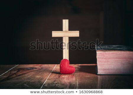 Close-up of Jesus Christ standing on book Stock photo © zzve