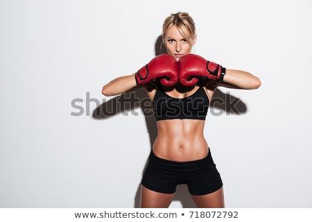 Güzel bir kadın boks kırmızı boks eldivenleri yalıtılmış siyah Stok fotoğraf © studio1901