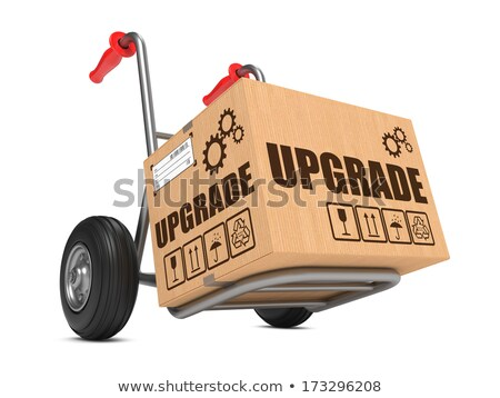 Upgrade - Cardboard Box on Hand Truck. Stock photo © tashatuvango