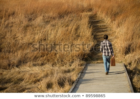 young man walks down the road Stock photo © feedough