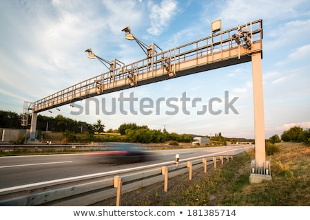 truck passing through a toll gate on a highway motion blurred i stock photo © lightpoet