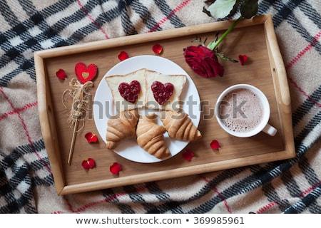 Tepsi kahvaltı çikolata yatak çiçekler Stok fotoğraf © Tagore75