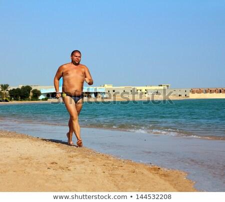 zdrowych · człowiek · uruchomiony · plaży · sportu · zewnątrz - zdjęcia stock © mikko
