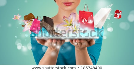 Foto d'archivio: Unrecognizable Woman Shopping Online Using Her Tablet Computer