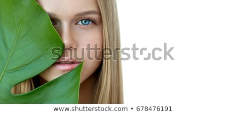 close up of a woman face with green plant stock photo © nejron