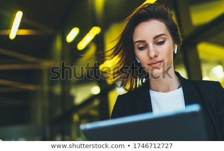 businesswoman using laptop outdoors stock photo © diego_cervo
