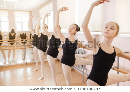 Stock photo: Ballet dancer doing exercise near the bar