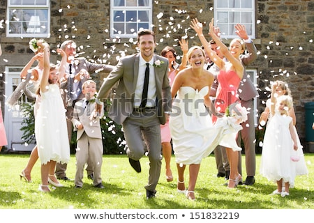 Guests Throwing Confetti Over Bride And Groom Stock photo © monkey_business
