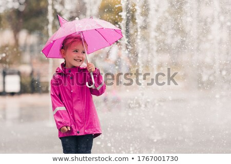 Young girl with an umbrella standing laughing Stock photo © stryjek