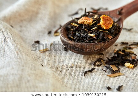 Dry tea and wooden spoons  Stock photo © punsayaporn