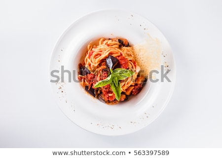 spaghetti with tomato sauce and a mozzarella in a plate top view stock photo © zoryanchik