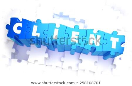Client - Word in Blue Color on Volume  Puzzle. Stock photo © tashatuvango