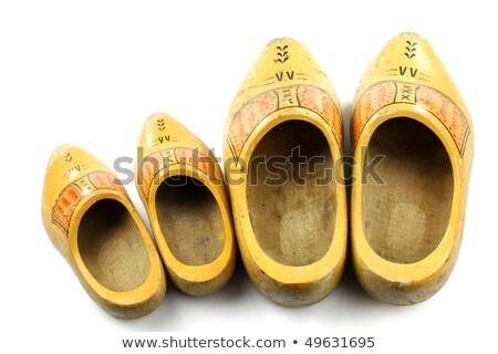 Old and young two pairs of traditional Dutch yellow wooden shoes Stock photo © peter_zijlstra