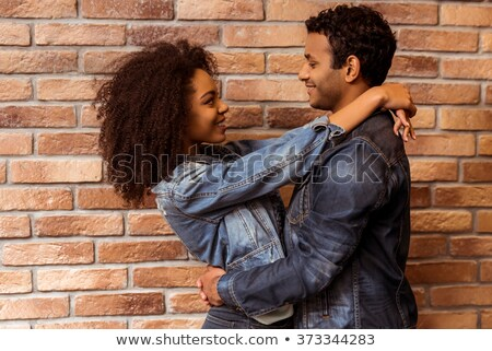 man leaning on a wall while looking at this lover stock photo © feedough