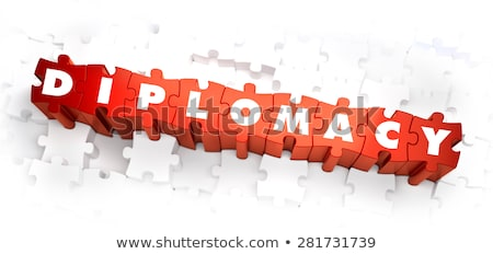 Diplomacy - Word on Red Puzzles.  Stock photo © tashatuvango