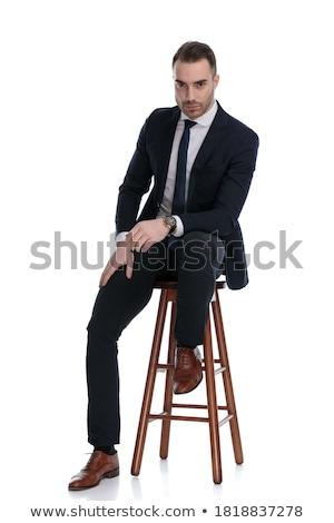 Vonzó fiatal üzletember ül zsámoly megjavít Stock fotó © feedough