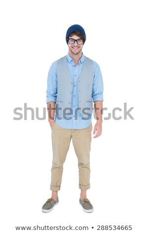 geeky hipster looking at camera with hand in pocket stock photo © wavebreak_media