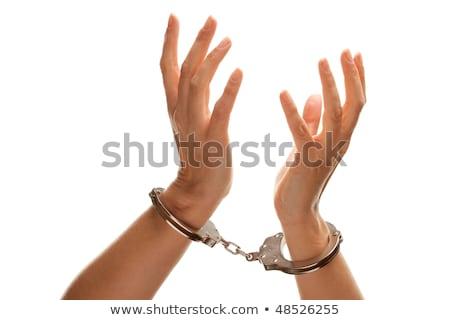 Handboeien vrouw handen lucht witte geïsoleerd Stockfoto © feverpitch