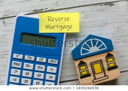 Debt word and business man toy Stock photo © fuzzbones0