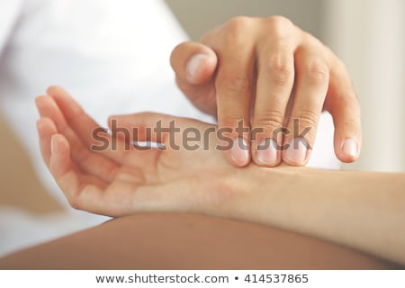 Measuring heartbeat on wrist stock photo © nyul