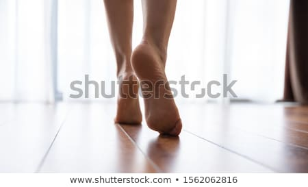 Woman goes on tiptoe Stock photo © OleksandrO