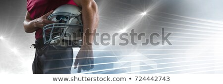 composite image of mid section of american football player holdi stock photo © wavebreak_media