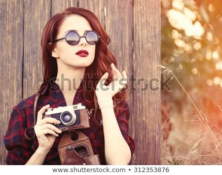 Portrait of a redhead women in tartan clothes Stock photo © Massonforstock