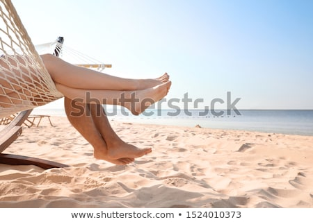 young couple relaxing in a hammock stock photo © dash