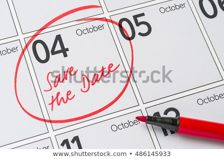 save the date written on a calendar   october 4 stock photo © zerbor