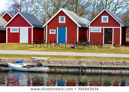Small wooden boats and canoes tied to empty pier Stock photo © stevanovicigor