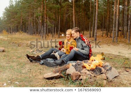 Couple spending time on the beach with their dog Stock photo © deandrobot