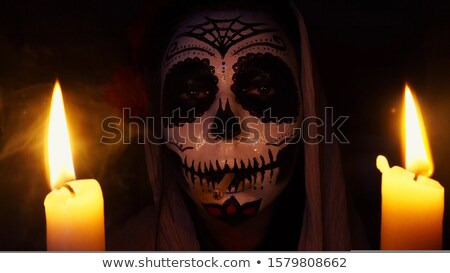 Portrait of young woman with frightening halloween makeup Stock photo © deandrobot