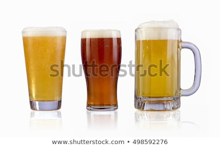 three cold beer isolated on white clipping path stock photo © kayros