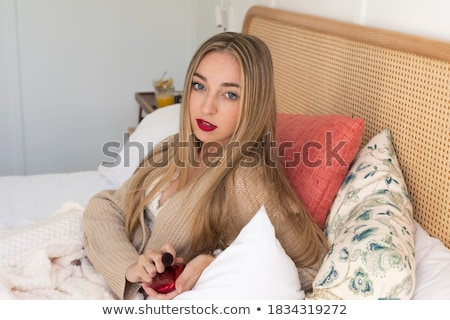 Portrait of beautiful blonde woman wearing sweater and red lipstick Stock photo © deandrobot