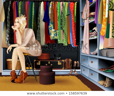 beautiful woman near wardrobe Stock photo © ssuaphoto