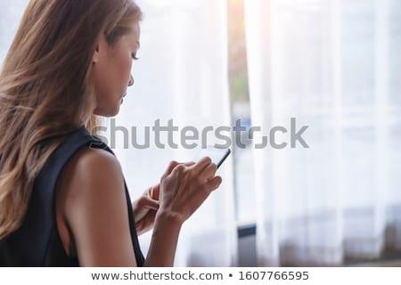 Vrouw zwart pak vergadering lang haar portret Stockfoto © deandrobot