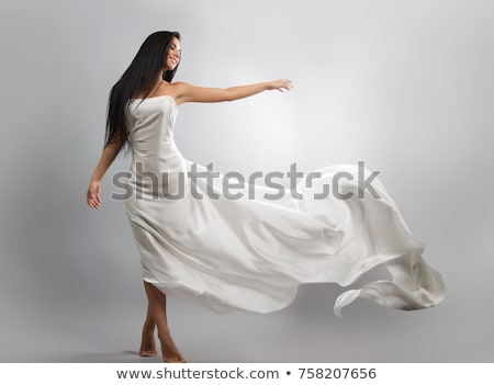 beauty brunette in white dress stock photo © konradbak