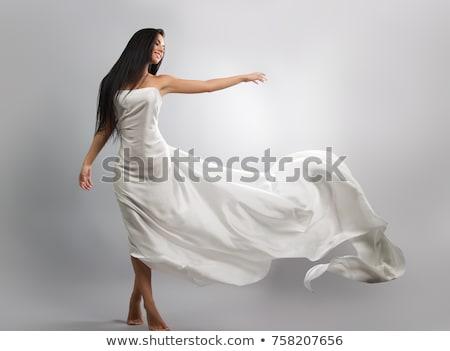 красоту брюнетка белое платье небе цветы лице Сток-фото © konradbak