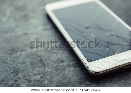 close up of damaged cellphone stock photo © andreypopov