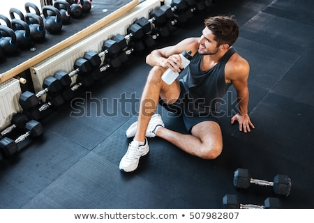 Healthy fitness man with barbells Stock photo © deandrobot