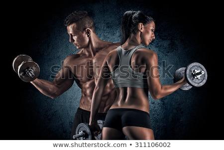 Férfi tornaterem testmozgás tricepsz súlyzó fiatal Stock fotó © Jasminko