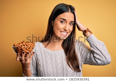 Sadness and pretzel. stock photo © Fisher