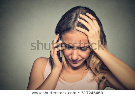 Portrait unhappy young woman talking on phone looking down Stock photo © julenochek
