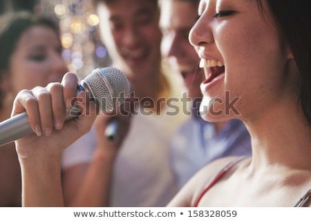 Közelkép nő nyitott szájjal éjszakai klub portré élvezi Stock fotó © wavebreak_media