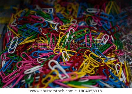 Close up of yellow paper pins on purple paper Stock photo © wavebreak_media