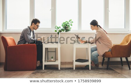 Side view of two women are discussing something Stock photo © deandrobot