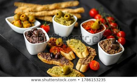 Marinált zöld olajbogyók pirítós tányér bézs Stock fotó © Digifoodstock